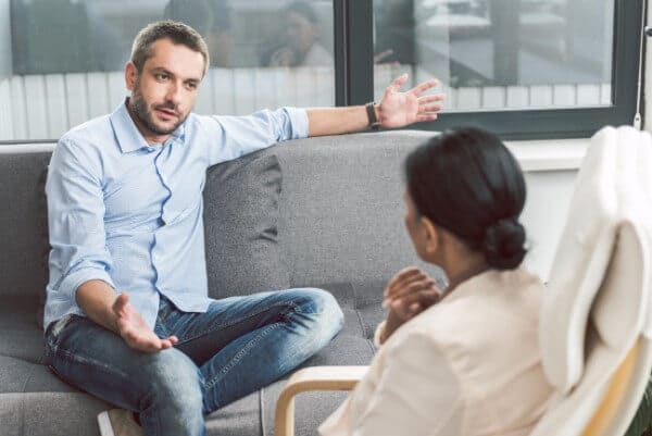 therapy therapist talking conversation man woman ladder of influence jumping to conclusions