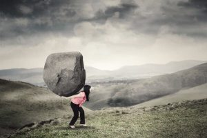 overwhelmed too much cope stress anxiety overwhelming rock mountain boulder woman