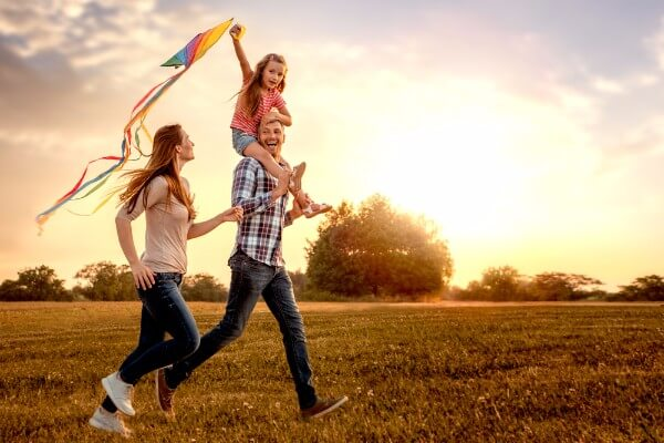 family happy field children couple sky sunset hypnosis tips for back to school term time holidays