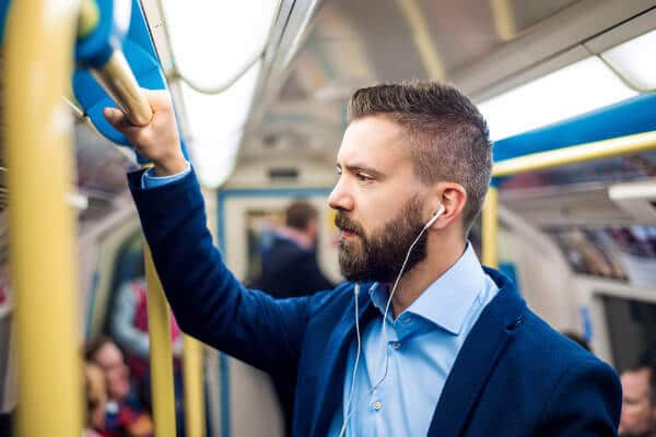 man tube london commute travel music ipod sounds headphones commute to work hypnotherapist hypnotherapy wellbeing at work