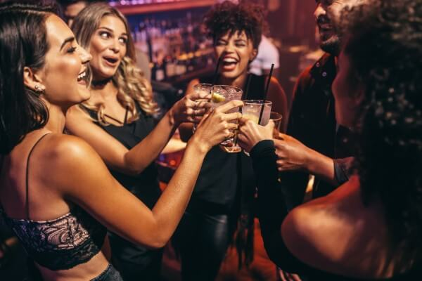 hypnotherapy and ego strengthening party women drinking alcohol fun smile laugh