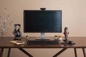 computer, microphone and headphones, ready for an online hypnotherapy session