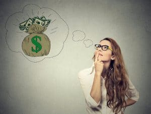 woman thinking about making money with an online hypnotherapy session