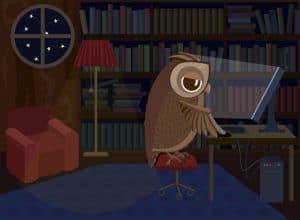 A night owl procrastinating at his desk