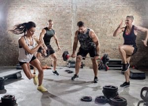 people working out at the gym, in order to sleep better