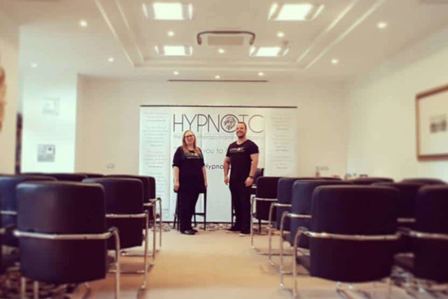 Rory and Kate at a free hypnotherapy taster event in London, standing in our dedicated training room.