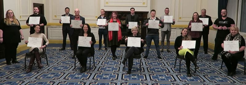 Hypnotherapy students and their diploma certificates, having passed the HypnoTC diploma course