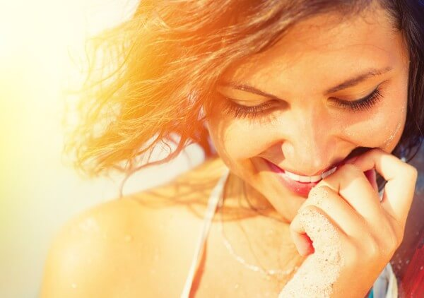 woman smiling as she has Unconditional positive regard for herself
