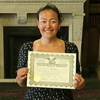 Hypnotherapy graduate, holding the hypnotherapy diploma certificate.